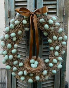 Spring Time Mossy Egg Wreath. Buy a styrofoam or foam core wreath and hot glue the spanish moss to it...then glue on eggs from a craft store.  Add a birds nest and some ribbon and you have a beautiful spring wreath for your door!