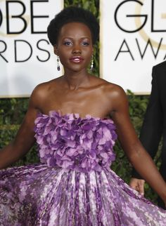 Lupita Nyong'o Pink and purple Giambattista Valli haute couture dress is so feminine and pretty and the floral bodice perfectly tops it off.