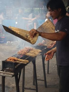 Sate | Satay | street vendor. Full of smoke. The smell stay on your clothes. Worth it though its so yummy with spicy peanut butter sauce...