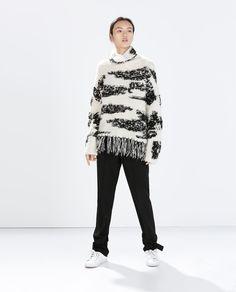 Patterned knit poncho Zara