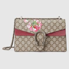 ae6d754db Shop the Dionysus small GG Blooms shoulder bag by Gucci. A structured GG  Supreme canvas