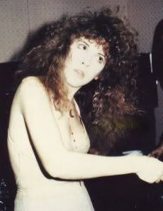 Stevie ~ ☆♥❤♥☆ ~     trying to brush her long tangle of curls before a concert
