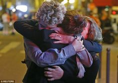 (Reuters) — Gunmen and bombers attacked restaurants, a concert hall and a sports stadium at locations across Paris on Friday, killing at least 129 people in what a shaken President Francois Hollande called an unprecedented terrorist attack. Death Metal, Bbc News, Paris Shooting, People Hugging, Pray For Paris, France Culture, Paris 13, Paris Attack, France