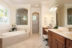 Master bath with dual sinks, separate tub and large walk-in shower.