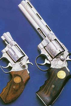 Nickel plated and adorned J frame Smith & Wesson alongside a Colt Python six-inch
