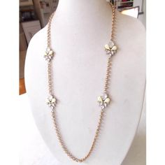 """Gold flower pastel station long chain necklace Lightly worn, so pretty. Decorative pale green and clear floral station rolo chain necklace. Not sure how to describe the pattern but kind of reminds me of the fleur de lis. Gold tone. Light weight, 36"""" long with lobster clasp. No trades please. Thanks! :) Jewelry Necklaces"""