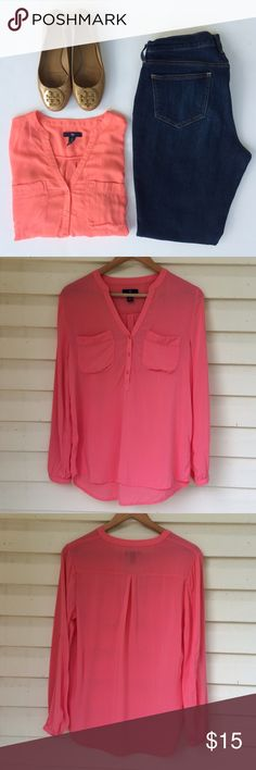 Gap Coral long sleeve blouse size S For sale is a very gently used Gap blouse.  Beautiful coral color.  2 breast pockets and 3 buttons.  Buttons on end of sleeves and even the ability to roll up and button for a different look.  I am not sure of the fabric because the tag has been cut off.  Looks so cute with leggings!  Comes from smoke free and pet free home.  Open to offers or save by bundling.  Thanks for looking!   GAP Tops Blouses