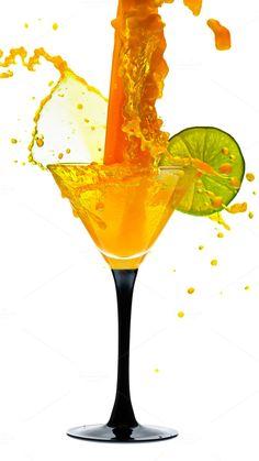 martini glass with lime and splash by Elena Vagengeim on @creativemarket
