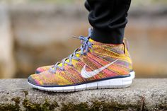 The popular Nike Free Flyknit Chukka gets a colorful makeover for the warmer months. In Navy/White-True Yellow, the silhouette boasts a mostly yellow upper, made of the breathable and lightweight Flyk...