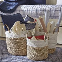 Reid Woven Baskets   Woven of natural raffia and shoelace, these three baskets lend color and texture to your space while offering stylish storage.