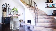Stairway to upstairs with wide open entryway