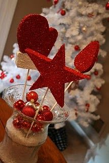 this would be cool for homemade lollipops - fill something with raw cane sugar add some mini ornaments and stick the lollipops into the sugar