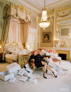 Karl Lagerfeld took over the first-floor-spanning Imperial Suite of the Ritz, seen here, for his 1996 couture collection. Kate Moss in Chanel Haute Couture embroidered organza flower coat and pumps.
