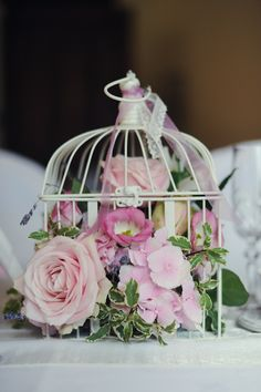 Maybe for the wedding centre pieces or the wedding stage can have these bird cages hanging with red white and orange flowers but the bird cages have to be in gold