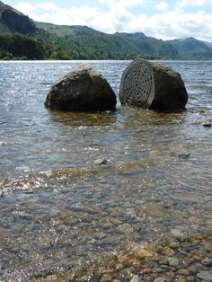 Sculpture in the landscape. This boulder of Borrowdale volcanic rock was split and carved by Peter Randall-Page to commemorate the National Trust's centenary in 1995. It is found in Derwentwater in The Lake District, England.