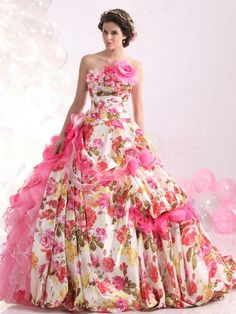 Like the floral fabric, hate the design:( Takeout all the ruffles and flowers and make it a strapless A-line and it would be gorg.