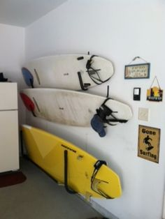 afraid this will happen if we put them on the wall--will just look sloppy no matter what Garage Storage, Storage Rack, Sports Equipment Storage, Surfboard Storage, Living Room Redo, Surf Gear, Hanger Hooks, Paddleboarding, Wall Racks