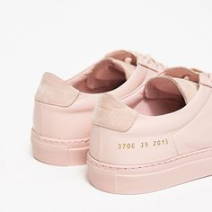 Premium low top sneaker from Woman by Common Projects in Blush. Smooth leather upper with suede insets. Lace-up front with flat laces. Leather lining. Heat pressed gold serial number detail at lateral side. Fashion Mode, Fashion Shoes, Mens Fashion, Ladies Fashion, Fashion News, Runway Fashion, Fashion Outfits, Classic Leather, Smooth Leather