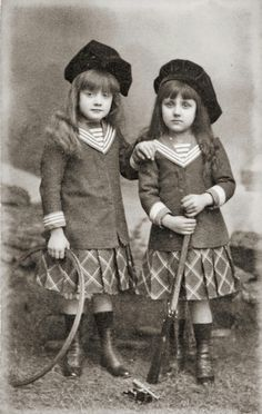 these could very well be boys not girls. Sisters, with rifle and cannon, Paris, 1890s  Photographer: Desiré, Paris