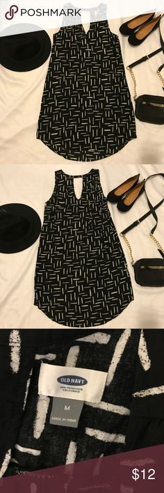 Old Navy Sleeveless Cutout-Back Shift Dress Old Navy sleeveless cutout-back shift dress with black and white designs.  V-neck front with cutout back V.  Worn once. Excellent used condition. Last pic is the same style in a different color. Old Navy Dresses