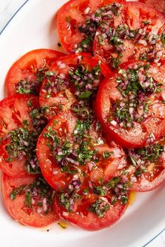 Garden fresh tomatoes marinated with red onion, garlic, and fresh basil and parsley. These flavourful tomatoes are a great side dish for any meal, or try them as a burger topper or on sandwiches! Marinated Tomatoes, Beefsteak Tomato, Italian Vegetables, Tomato Seeds, Tomato Tomato, Cooking Recipes, Healthy Recipes, Healthy Meals, Healthy Food