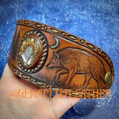 Welcome to see more pictures of this #handmade #wolf #bracelet in my #etsyshop #Gemsplusleather 😉 Just remember that ordering outside #Etsy is cheaper thus rather contact me directly 🙃 #Gemsforall #cuff #handtooled #ammonite #leather #tooledleather #leathercraft #Leatherwork #artisan #artisanjewelry #leatherjewelry #gemstonejewelry #Handpainted #giftforher Leather Ring, Leather Cuffs, Leather Necklace, Leather Tooling, Leather Jewelry, Tooled Leather, Leather Gifts For Her, Ammonite, Artisan Jewelry