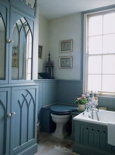 Found on decordesignreview.tumblr.com Helen Milinkovic Helen Milinkovic • 1 year ago gothic cupboard and woodwork in this blue English bath