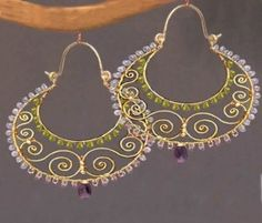 Siren 228 Amethyst, tanzanite, and peridot wrapped on hammered swirl shaped hoops