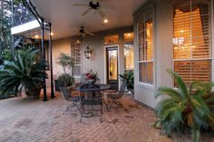 Downstairs courtyard is a pleasant and unusual way to enter the front door.  Shielded from harsh weather and so private due to the privacy wall which encloses the courtyard. Easy to maintain pavers. New Orleans style columns.