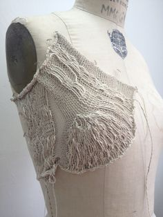 Contemporary knitwear design development with structured knit construction for fashion; knitted textures