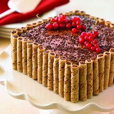 Chocolate Pirouette Crusted Cake: crumble pirouettes on top with two whole ones overlapping for design