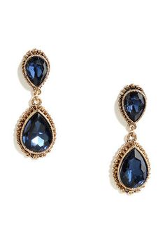 """No need to be modest, you're the belle of the ball in the Astute Courtier Gold and Blue Rhinestone Earrings! Teardrop-shaped blue rhinestones are nestled in shiny gold settings. Earrings measure 3"""" long."""