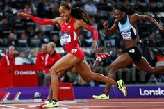 Sanya Richards-Ross crosses the finish line to win gold in the women's 400-meter final on Sunday at the Olympic Stadium in London. In winning, Richards-Ross captured the first US gold in track & field at these games.