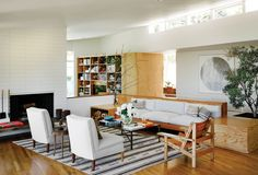 Soft textiles and vintage Moroccan rug warm up the living room's built-in sofa.  Photo: Douglas Friedman