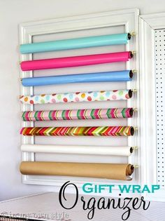 Gift wrap organiser, could use for ribbon storage or maybe fabric storage too. 50 Genius Storage Ideas (all very cheap and easy!) Great for organizing and small houses.