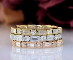 Yellow, rose, and white gold stackable bands with baguette and round diamonds.