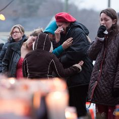Danbury, Conn. residents Maria Romero, her two daughters Elizabeth and Jelsey (sic), and the girls' aunt Carmen Cohen (left to right) embrace at memorial in the center of the village of Sandy Hook Sunday. (Photo: David Friedman / NBC News) #Newtown