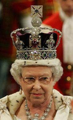 """HRH is wearing the Imperial State Crown of Great Britain, which incorporates the """"Black Prince's Ruby"""", a 140 ct. Badakhshan spinel. The crown was modified for Queen Elizabeth II prior to the 1953 coronation."""