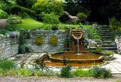 Chalice Well in Glastonbury, Somerset, England. One of the most serenely beautiful places I've ever been. Glastonbury England, Glastonbury Abbey, Glastonbury Somerset, Mysterious Places, England Uk, Somerset England, Spring Nature, British Isles, Travel Pictures