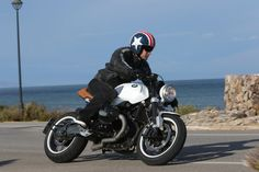 The Wunderlich White Star custom BMW R nineT Cafe Racer uses parts from the German BMW accessory firm to show what is possible from their catalogue Custom Bmw, Custom Cafe Racer, Bmw Cafe Racer, Street Tracker, Triumph Bonneville, Honda Cb, Audi Tt, Ford Gt, Bmw Nine T Scrambler