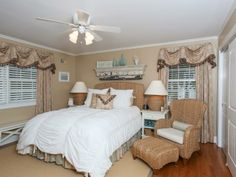 Tranquil bedroom retreat in neutral, beach tones with sea grass accessories in Sea Girt, NJ