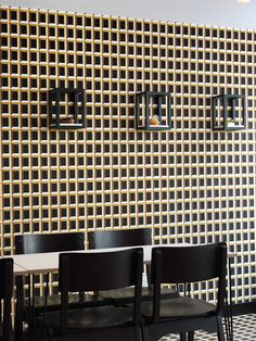 Optical-illusion wallpaper used in London bakery.