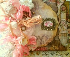 Mini album created by Rhue Chantal.  I love lush, exquisite layering of laces, flowers and leaves, combined with elegant paper lines. This mini album is so pretty inside, with matching lace for pockets, to tuck tiny treasues, photos and journaling cards!