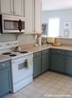 I think I like the idea of a 2 tone paint in kitchen with upper cupboards white and lower cupboards a different color.