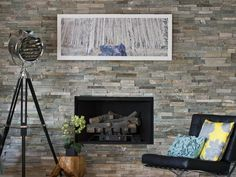 There's an urban vibe to the stone surround of this fireplace.