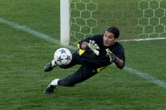 Goalkeeper Jose Manuel Pinto of FC Barcelona stops the ball during the training session the day before the UEFA Champions League Quarter-final match between Atletico de Madrid and FC Barcelona at Vicente Calderon Stadium on April 8, 2014 in Madrid, Spain.