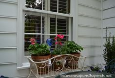 """I found this plant stand in Marshall's a few years back and it was the perfect height for what I was trying to do in this spot.  I wanted the geraniums to look kind of like they were growing in a window-box, so this was my sneaky way of getting a window-box planter """"look"""" without actually having to mount one under the window."""