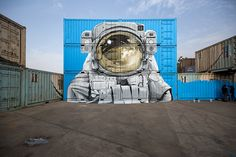 nevercrew sits an astronaut on top of their new delhi street intervention