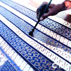 BATIK: Applying dye to the wax resist fabric. From thedailyroar