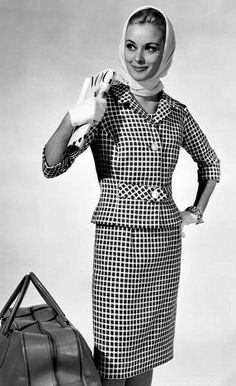 Model in stylish travel dress and matching short jacket by Brilkie, photo by Chaloner Woods, 1963